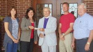 photo of check being given for tornado relief