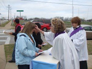 Photo of Episcopal Priest giving Ashes to Go