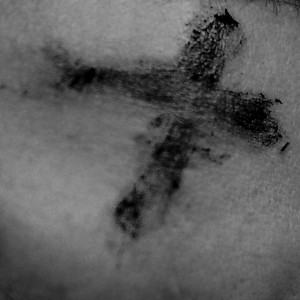 Photo of ashes in the sign of a cross