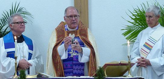 Bishop offering bread